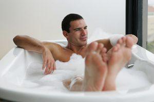 Young man relaxing in bubble bath